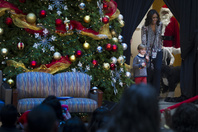First Lady Michelle Obama, accompanied by first dogs, Bo and Sunny, visited Children's National for an annual holiday visit with patients and families, Dec. 14, 2015. Mrs. Obama read the classic 'Twas the Night Before Christmas' and answered questions from children about her family's holiday traditions. (Photo by Preston Keres/Children's National)